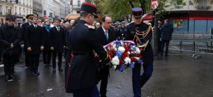 President François Hollande placed flowers and unveiled plaques at each of the sites of the attacks.  Photo by Philippe Wojazer